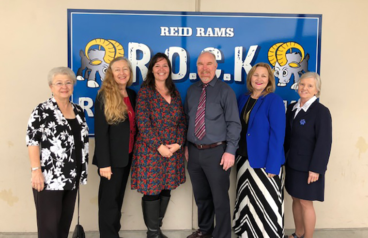 Board Members with Mrs. Helenihi and Dr. Johnson at Reid School