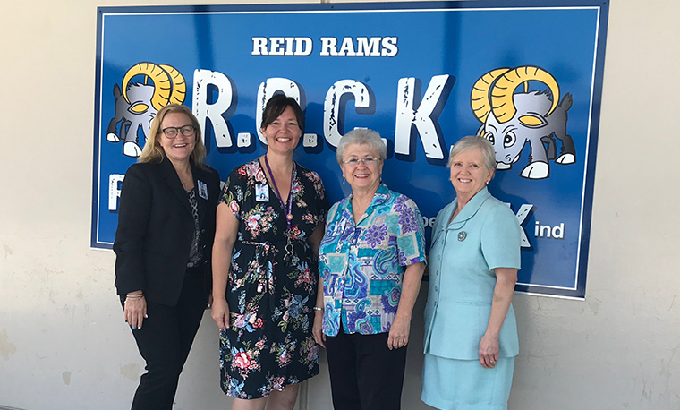 Board Members and Dr. Johnson at Reid wall